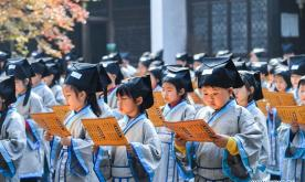 Pupils learn Chinese traditional culture at school in Zhejiang