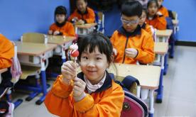 Pupils make dough figurines in Beijing