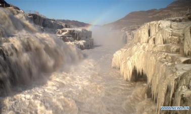 Rainbow over Hukou Waterfall of Yellow River