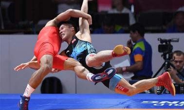 Highlights of men's freestyle wrestling at 18th Asian Games