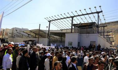 Yemeni people rally against continuing war and blockade outside UN office in Sanaa