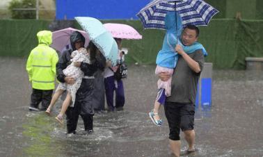 Typhoon Rumbia leaves heavy damage; 2 killed